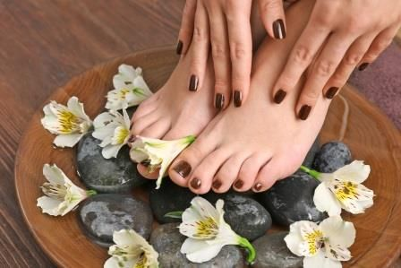 A Calgary woman's pedicured and manicured feet and hands